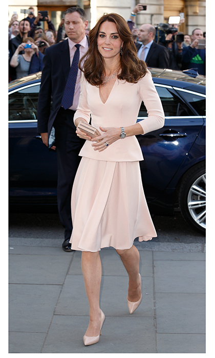 Thinking pink is always a good idea, especially when it's Alexander McQueen! Kate wore this peplum dress as she stepped out to view the Vogue 100: A Century Of Style exhibition at the National Portrait Gallery.