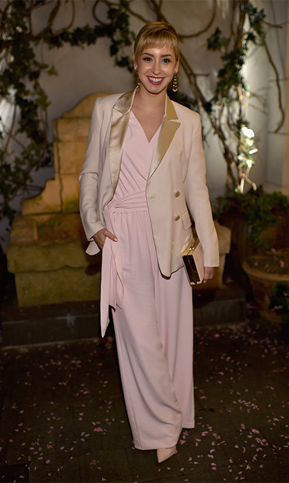 Rocking a pale pink jumpsuit, the Fordham University graduate, stood out from the crowd at the <i>Mother's Day</i> premiere by finishing off her look with a statement blazer and a matching cream and gold clutch bag.