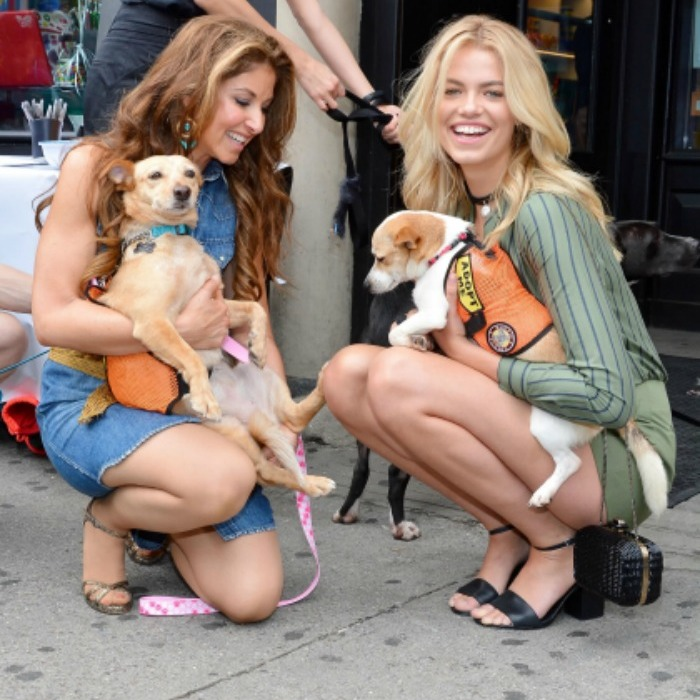 May 15: Sweet companions! Dylan Lauren and Hailey Clauson posed with some furry friends during the dog rescue event held at the Union Square location of Dylan's Candy Bar in NYC, where guest could rescue pups from the  Animal Lighthouse Rescue (ALR) and Monmouth County SPCA.