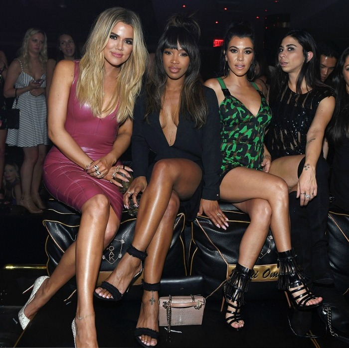 May 28: Party girls! Khloe Kardashian was a latex Barbie doll as she partied in Vegas with BFF Malika Haqq, big sis Kourtney Kardashian and birthday boy Scott Disick at 1 Oak.