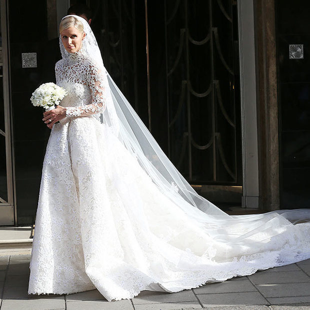 Inspired by Princess Grace of Monaco, Nicky chose a bespoke Valentino gown for her big day. The heiress added a long lace veil to finish off her bridal look.