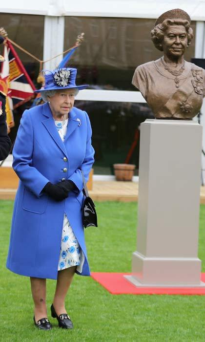 Double take! Queen Elizabeth was the guest of honor at the Artillery Company where she was presented with a bronze bust of herself. The statue was created to celebrate the Queen becoming the longest serving Captain-General of the Company.