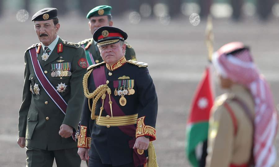 Dressed in his full military regalia, King Abdullah II of Jordan reviewed the Jordanian military units during a parade to celebrate the 100-year anniversary of the Great Arab Revolt in Amman.