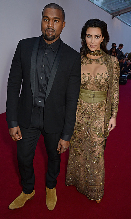 For British Vogue's Centenary gala dinner at Kensington Gardens in May 2016, Kim went for a see through green gown with a botanical motif, and Kanye wore a dark suit. 