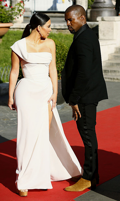 A night at the opera: Kim donned a goddess-like one shouldered gown for the 'La Traviata' Premiere at Teatro Dell'Opera in Rome, Italy, and her famous date stuck to his signature tux and brown suede boots combination.
