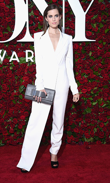Allison Williams turned heads donning a custom all-white DKNY jumpsuit paired with a statement clutch. The <i>Girls</i> star completed her sleek look with her hair slicked back.