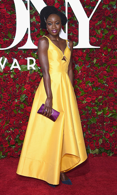 Danai Gurira, who earned a Best Play award nomination for <i>Eclipsed</i>, looked bright at the award show wearing a yellow frock and purple clutch.