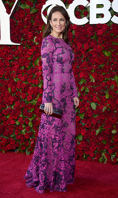 <i>She Loves Me</i> nominee Laura Benanti looked sophisticated in a purple, long-sleeve Oscar de la Renta embroidered gown.