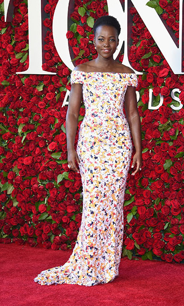 <i>Eclipsed</i> actress Lupita Nyong'o was the epitome of elegance in an off-the-shoulder, multi-colored floral print gown.
