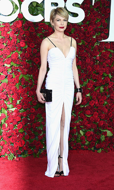 <i>Blackbird</i> nominee Michelle Williams was a vision in white stepping out in a ruched Louis Vuitton gown. The actress completed her look with a bold red lip.
