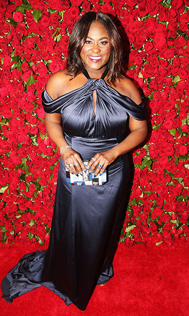 <i>The Color Purple</i> nominee Danielle Brooks stepped out for the show in a dark navy, off-the-shoulder gown with a key hole detail.