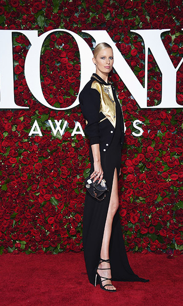 Karolina Kurkova looked chic in a black gown that featured a thigh-high slit. The model topped off her look with a black and gold jacket.