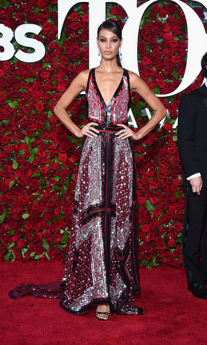 Model Joan Smalls turned the carpet into her personal runway working her paisley print Altuzarra gown.