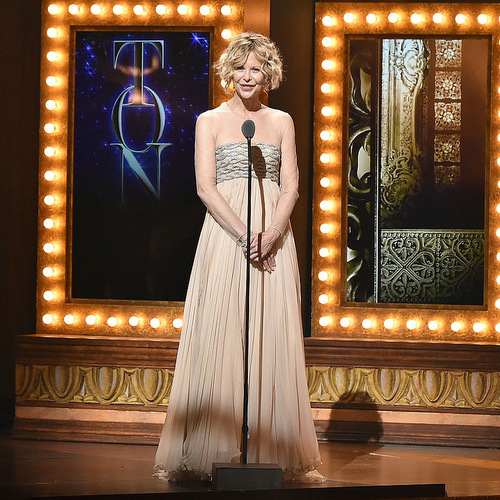 Actress Meg Ryan spoke on stage at the award show wearing a strapless ethereal dress.