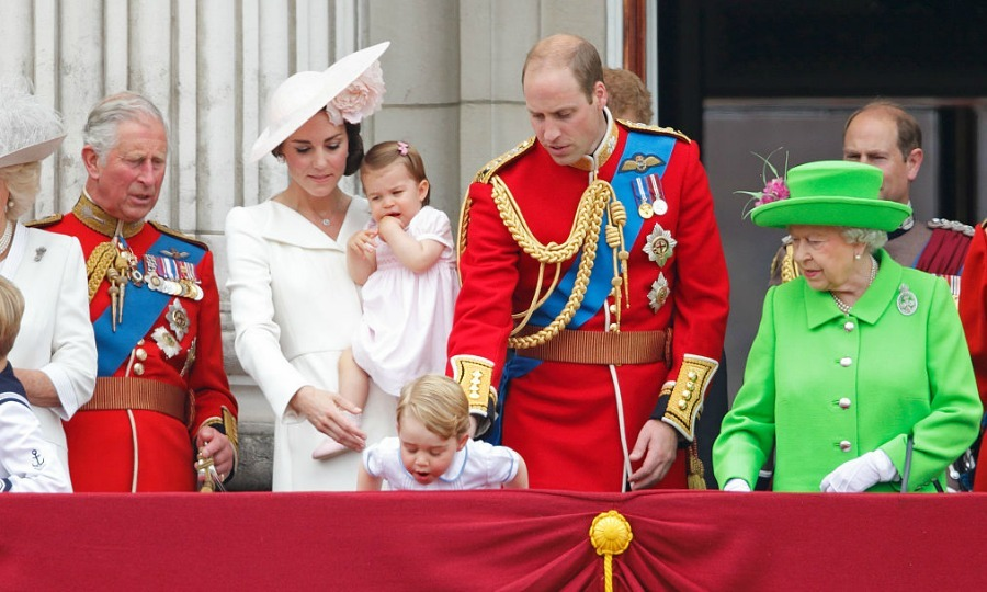 George made members of his family a bit nervous as he peered over the balcony of Buckingham Palace.
