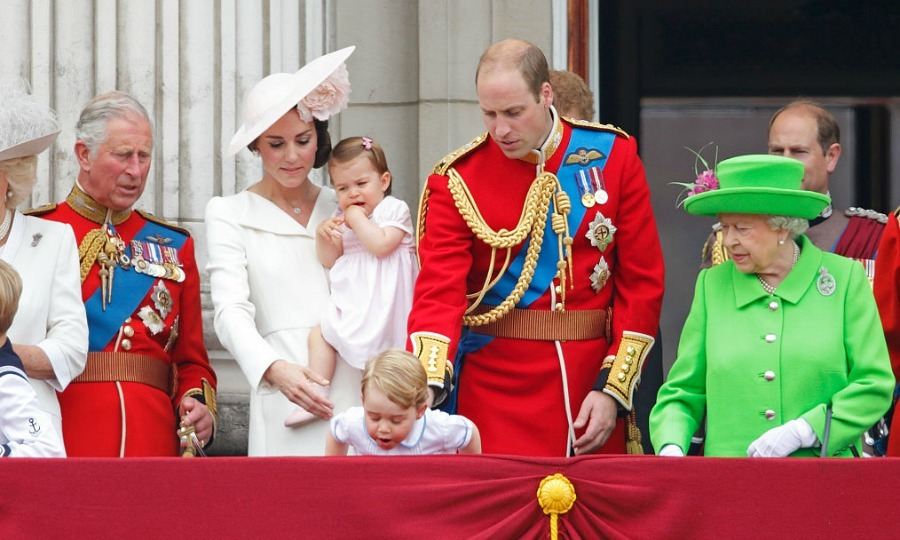 Like any father, Prince William kept a close watch on his son as George peered over the balcony of Buckingham Palace.