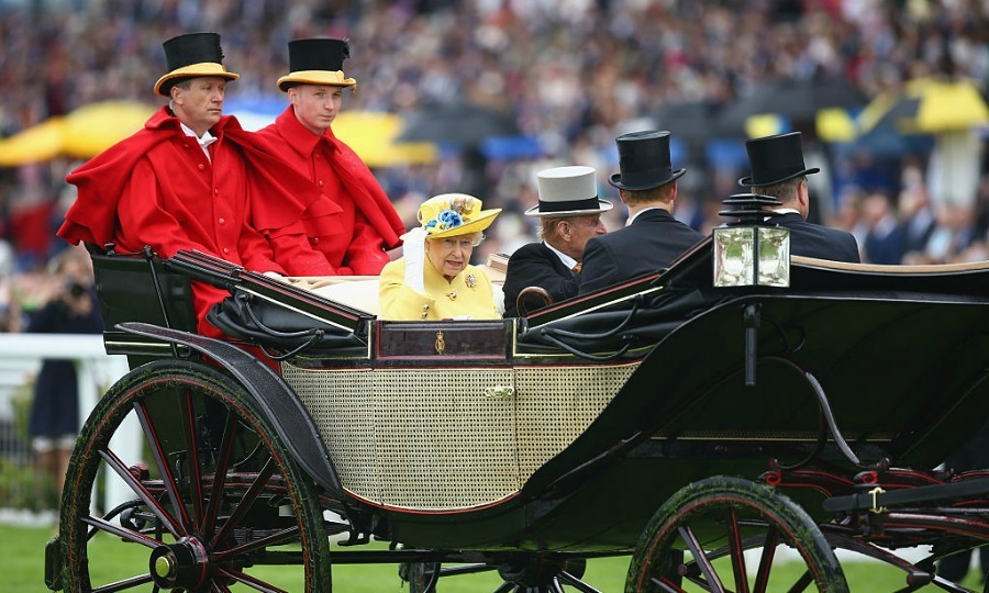 The Queen held on to her hat as she entered the track.