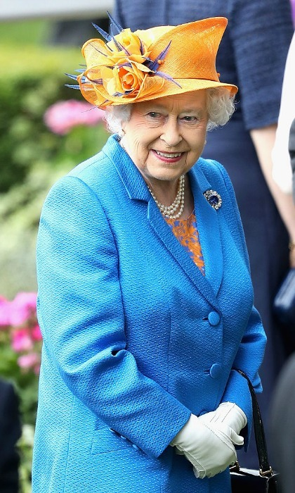 Queen Elizabeth made a colorful statement stepping out to the racetrack on June 16 wearing a vibrant blue coat, which she paired with an orange floral embellished hat.