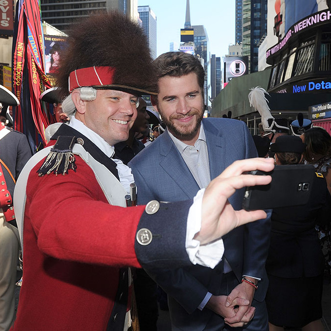 Say cheese! Liam Hemsworth had the perfect selfie moment with a dress up fan during an event in NYC.
