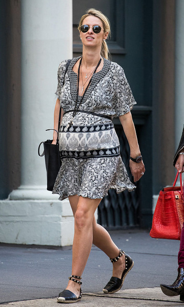 Keeping it effortlessly cool strolling around New York City in a black bohemian printed dress and studded espadrilles.