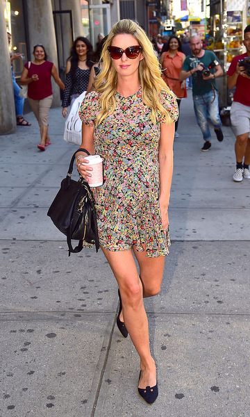 Nicky rocked the perfect summer look on the streets of New York wearing a floral mini dress that she paired with $5 sunglasses that she purchased from a street corner vendor.