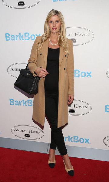 Paris Hilton's sister looked chic and classic wearing a black ensemble that she topped off with a camel coat and strand of pearls for the Animal Haven: Shelter Opening Celebration.