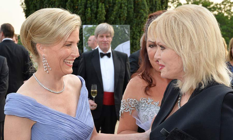 Even the Countess of Wessex couldn't resist a giggle when she met with comedienne Joanna Lumley, at a Gala Evening to honor the The Duke of Edinburgh's award.