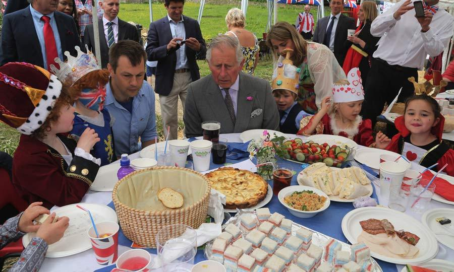 Tea for all. Prince Charles joined royal fans at the Patron's Lunch to celebrate his mother's official 90th birthday.