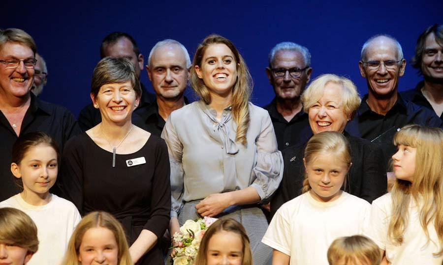 Theatre lover Princess Beatrice was thrilled to visit the Theatre Royal after it re-opened following renovations. Enjoying a tour around the redesigned auditorium, the royal stopped to take a photo with school children who had been practicing a Shakespeare play.