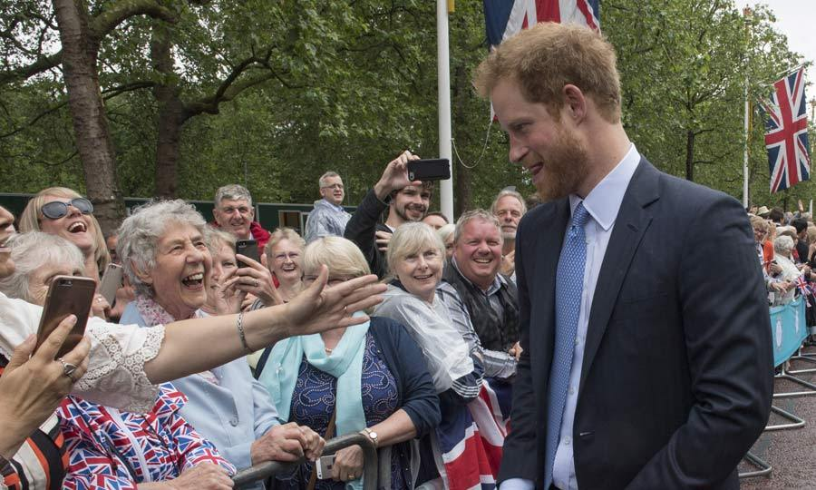 Prince Harry adored! Queen Elizabeth's grandson delighted royal fans when he walked down The Mall in London and stopped to chat to well-wishers