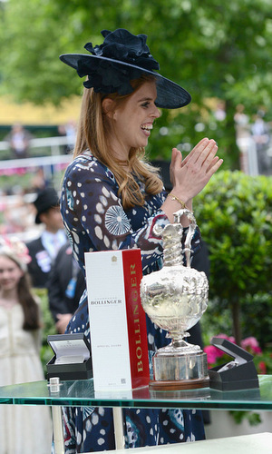 Princess Beatrice beamed with excitement, while passing out trophies on the last day of the races.