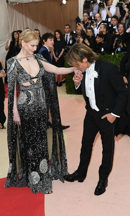 A kiss for his princess. The <i>Ripcord</i> artist kissed his stunning wife's hand at the Manus x Machina: Fashion In An Age Of Technology Costume Institute Gala.
