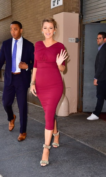 The star dressed her bump in an Oscar de la Renta bordeaux crepe dress while out and about for press in NYC. 