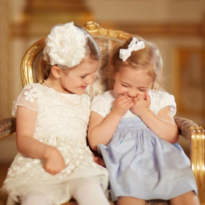 May 2016: Cousins Princess Estelle and Princess Leonore shared a laugh in a portrait taken from Prince Oscar's christening day.