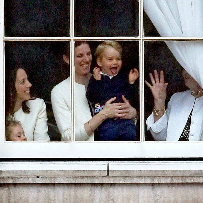 June 2015: Prince George was one happy camper, while looking through a window at Buckingham Palace prior to the Trooping the Colour ceremony.