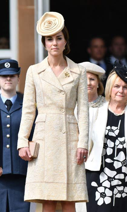 Holding a trendy box clutch, Kate wore a brocade coat dress and matching fascinator to attend the the Secretary of State's annual Garden party at Hillsborough Castle in Belfast.