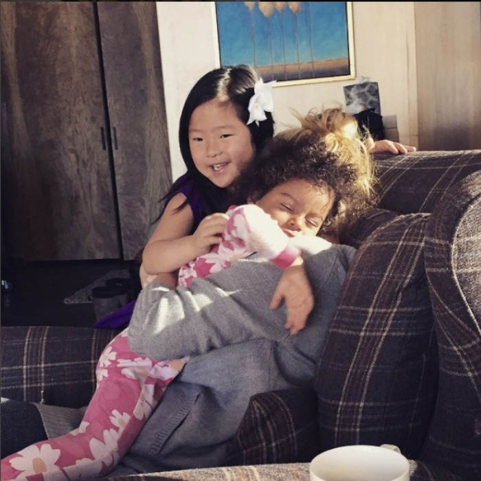 "Josh captured Naleigh and Adalaide getting in some quality cuddle time with ""mama bear"" Katherine. 