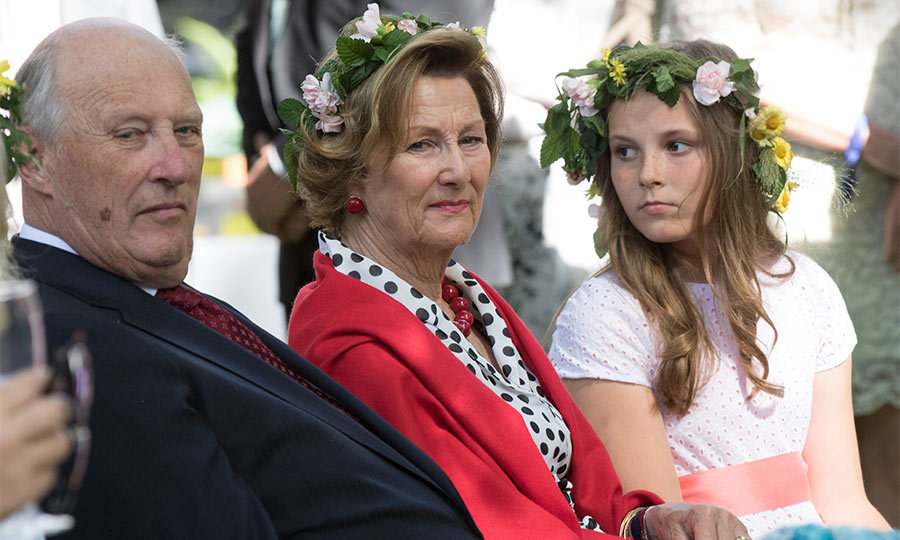 Princess Ingrid, third-in-line to the Norwegian throne, looked adorable in a pale pink dress and matching pink flower crow, as she sat next to her grandparents at the royal garden party.