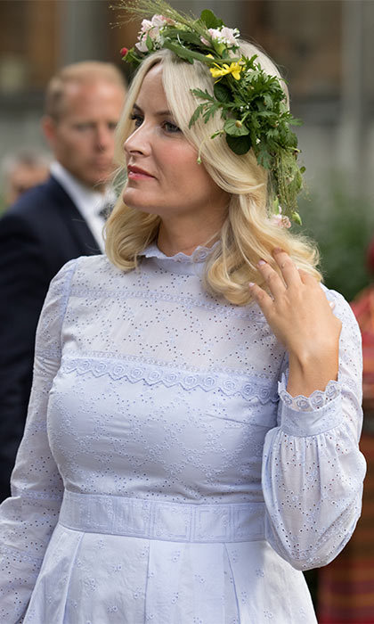 Mette-Marit wore a chic lilac dress that she paired with nude heels and a straw clutch. She finished her look by wearing a floral crown in her blonde tousled hair.