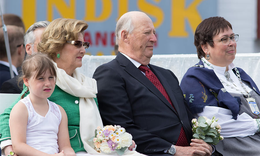 Emma Behn sat patiently with her grandparents as they watched a parade put on in King Harald's honor.
