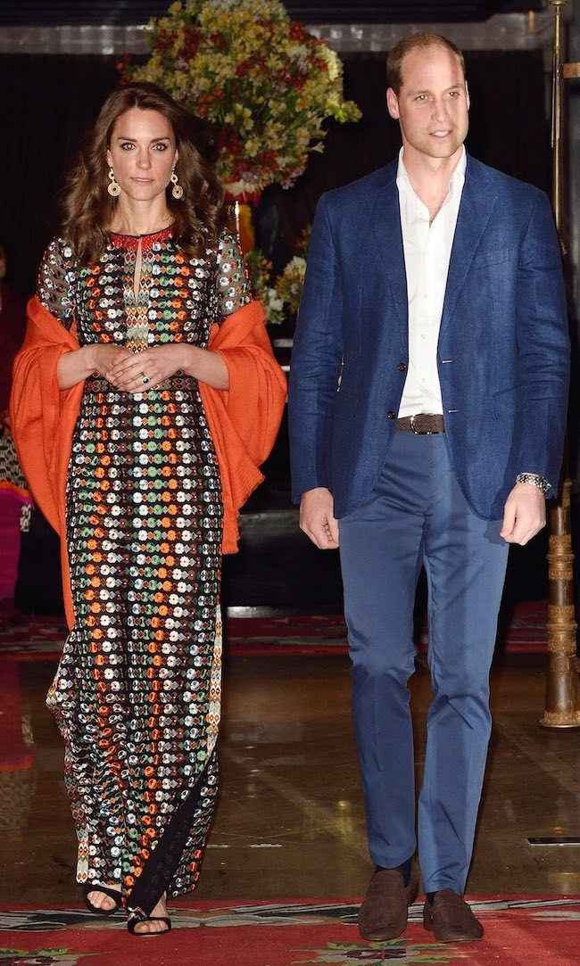For her final engagement during her royal tour of India and Bhutan, a private dinner with the King of Bhutan, the Duchess of Cambridge slipped into a spotted maxi dress by American designer Tory Burch. The gown featured a classic column shape and was embroidered with jewel-toned flowers and beading. She topped off the fun dress with a burnt-orange shawl.