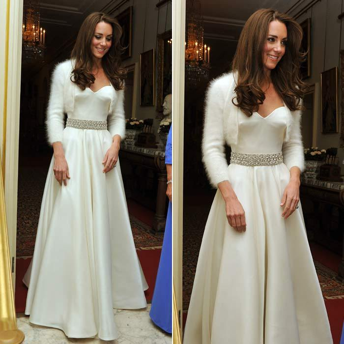 After wowing the world in a magnificent Alexander McQueen gown when she married Prince William on April 29, 2011, Kate changed into this equally stunning satin number with a fur bolero.