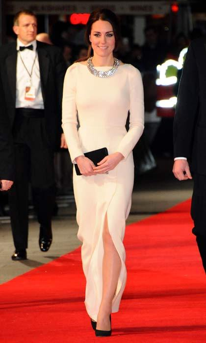 Kate dazzled at the Mandela: Long Walk to Freedom premiere in London, recycling a white Roland Mouret gown paired with a statement necklace from Zara in December 2013.