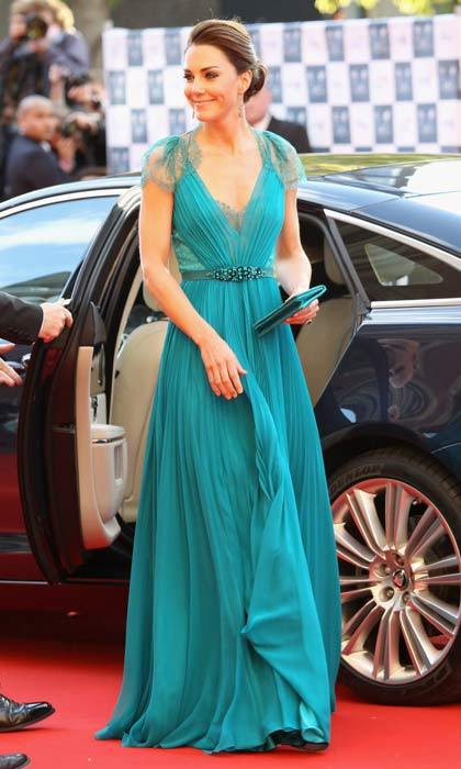 In a more daring sartorial choice for Kate, the royal dazzled in this teal Jenny Packham gown as she attended the Olympic Concert in London in May 2012.
