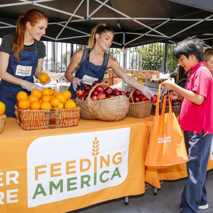 "June 23: Ashley Greene and Darby Stanchfield partnered with Feeding America and the Los Angeles regional food bank for the ""Put the Heat on Hunger"" event at Para Los Niños Charter Elementary School in L.A. 