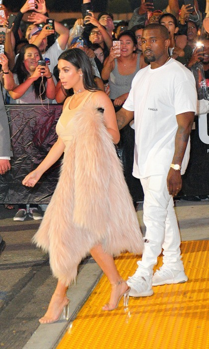 June 24: Kim Kardashian and Kanye West walked inside of the Forum in Los Angeles for the premiere of the rapper's latest visuals to his song <i>Famous</i>. Not only does the video include the controversial line about Taylor Swift, it features look-alikes of the singer, Donald Trump, Ray J and a slew of other A-List celebrities. 