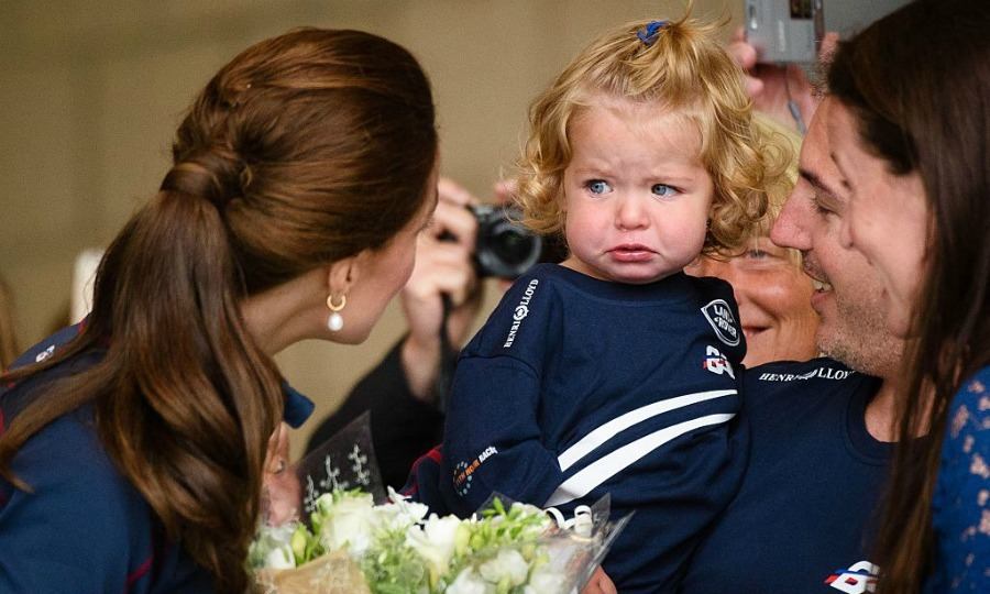 "Why so sad? One adorable little tot wasn't susceptible to <a href=""https://us.hellomagazine.com/tags/1/kate-middleton/""><strong>Kate Middleton</strong></a>'s charm at the British Land Rover BAR America's cup team center in 2015. 