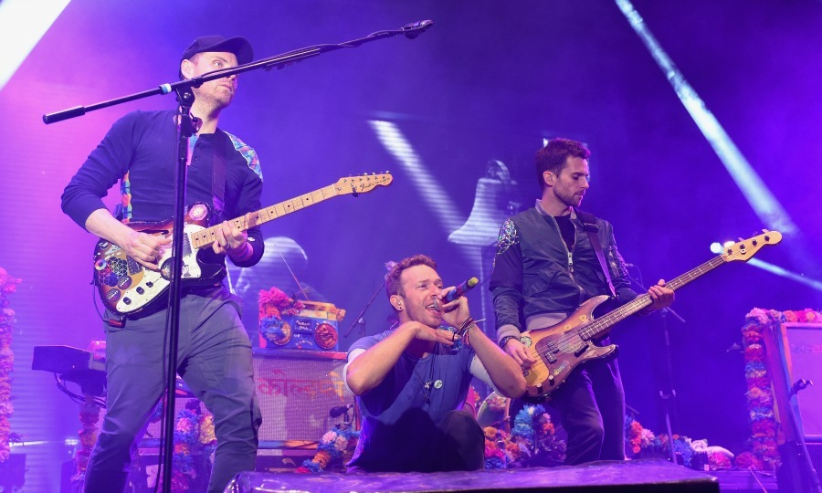 Coldplay took the stage during the Sentebale concert at Kensington Palace. The charity event was the first ever pop concert to take place on the East Lawn. 