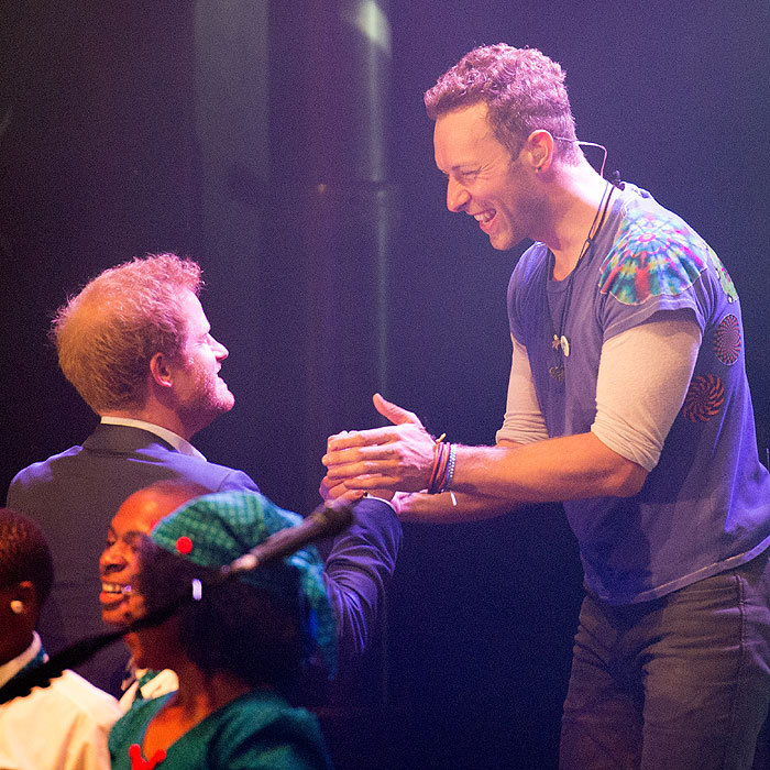 It was hard to tell who looked more thrilled – Harry or Coldplay frontman Chris.