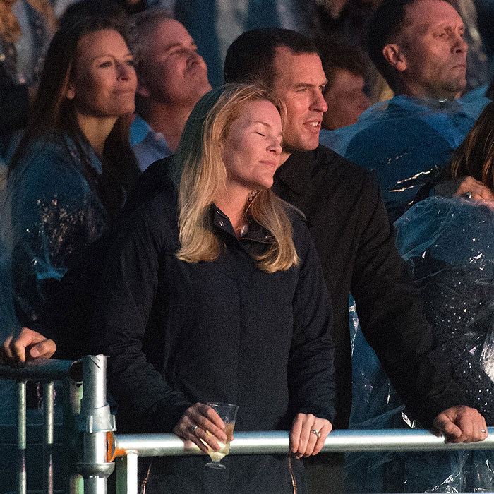 "The wet weather certainly didn't spoil date night at the concert for <a href=""https://us.hellomagazine.com/tags/1/peter-phillips/""><strong>Peter Phillips</strong></a> and his wife Autumn.